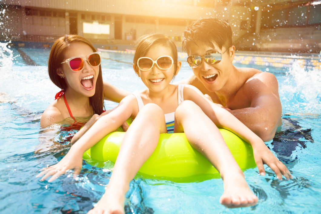 Happy family playing in swimming pool, staycation, asian, singapore, travel, hotel