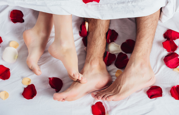 couple in bed of roses fertility home treatments