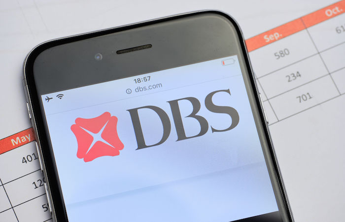 how to save money in singapore by not paying to transfer money  - DBS on phone