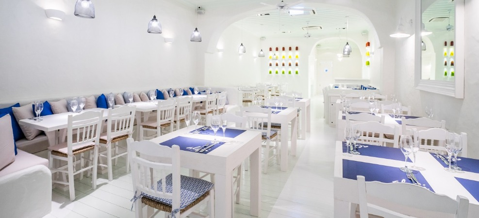 Alati Divine Greek Cuisine Restaurant, with a blue and white interior, in Amoy Street, Singapore