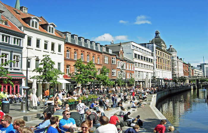 """Quayside in Copenhagen Denmark, shows """"Hygge"""",secrets to a happy life, in the world's happiest countries"""