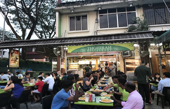 Customers flock to Jalan Kayu Thohirah Restaurant for suppers of prata and curry