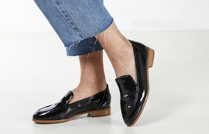 Large size women's shoes in a black leather slip-on design, by Hush Puppies