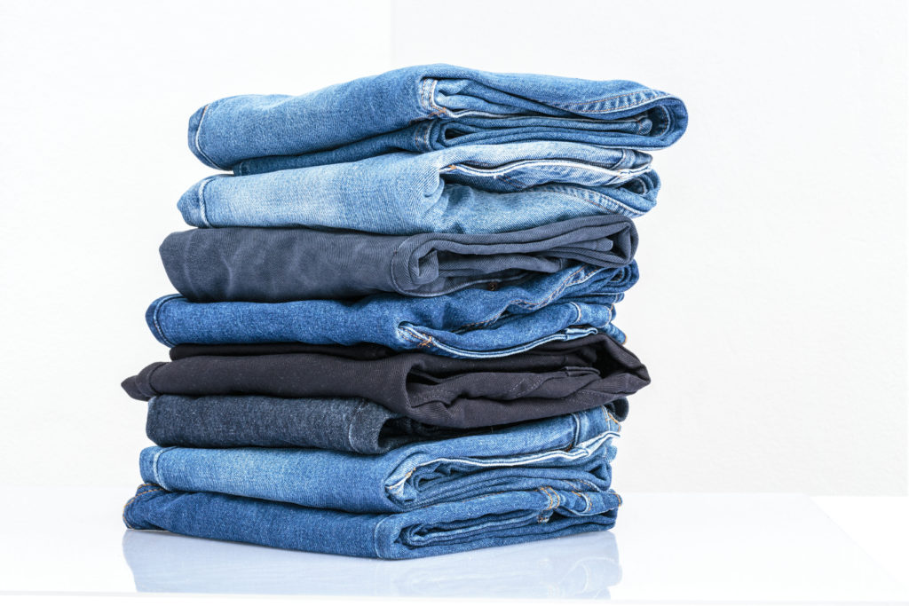 Stack of jeans that can be cut into shorts.