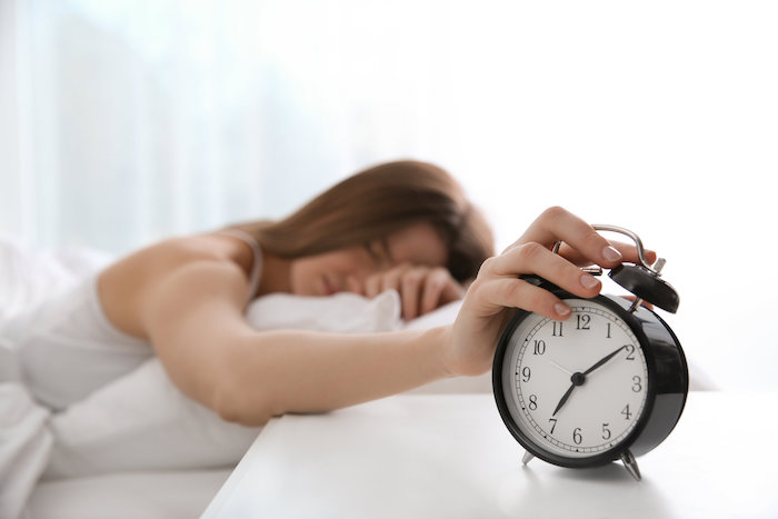 not using the snooze button can help you sleep better