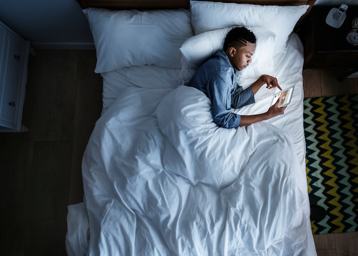 stop using your phone in bed, because it disrupts your sleep