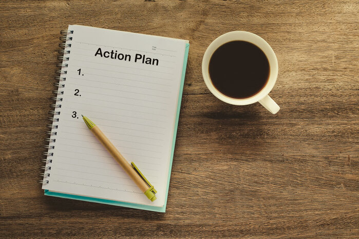 note pad with action plan listed, to show self improvement