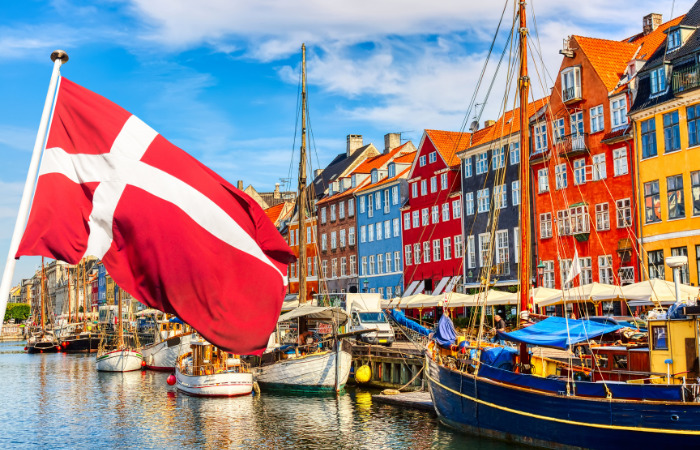 Copenhagen, Denmark country city with flag and colour buildings