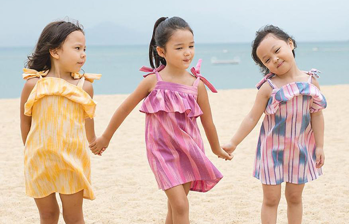 3 little girls on the beach in Little Islanders sustainable kids clothing brand, in Singapore