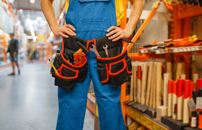 man with tool kit in DIY store to show how to save money in Singapore