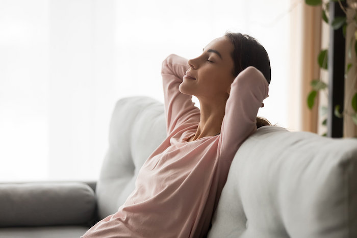 Woman trying the 4-7-8 breathing exercises to sleep better