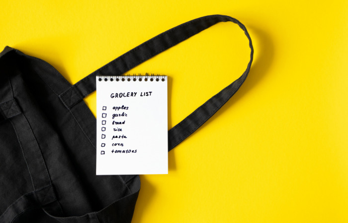black grocery bag and grocery list eco friendly habits