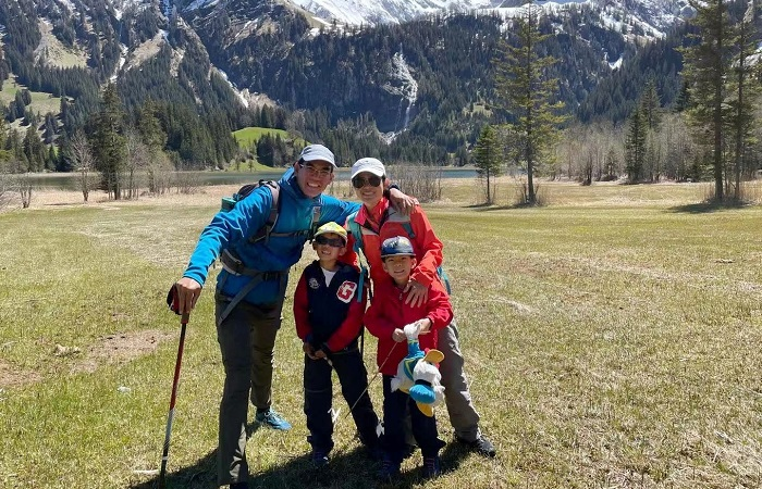 Oliver and Candy Kuan with their children in Switzerland for an article aout couples who met in a foreign country