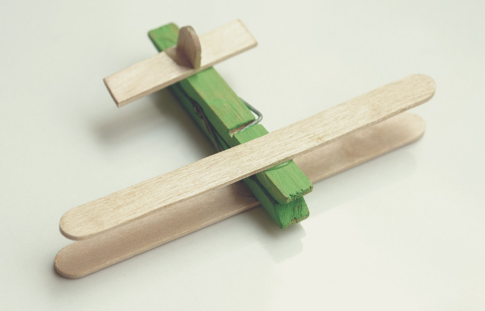 toy plane made from ice cream sticks and clothespin eco friendly