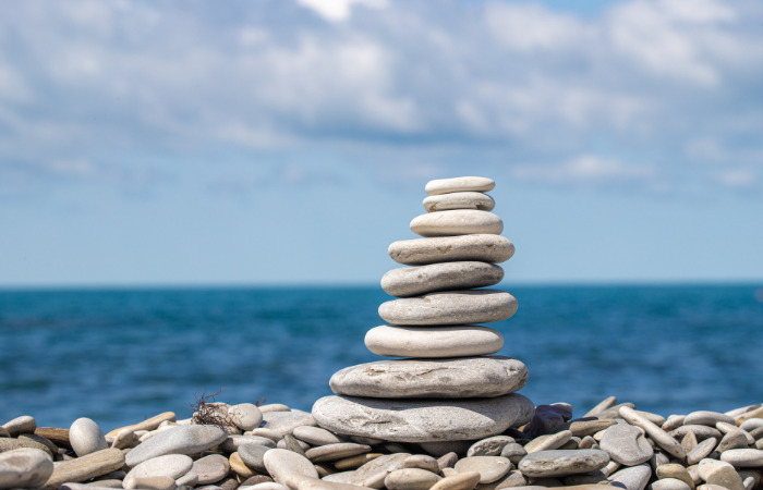 stones stacked on the beach representing stillness