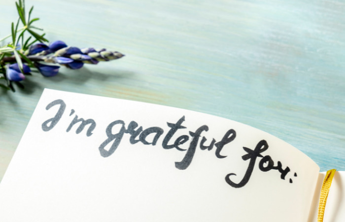 journalling for mental health with calligraphy saying i'm grateful for what is ocd world mental health day